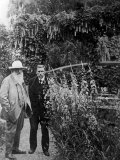 French Painter Claude Monet and Gustave Geffroy Walking in Monet's Garden Lámina fotográfica de primera calidad