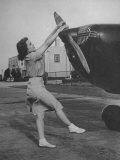 Woman Turning Propeller to Start Plane Premium Photographic Print by David Scherman