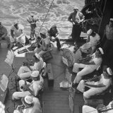 Members of Ship's Band Aboard US Navy Cruiser Playing on Deck, Daily Musical Practice During WWII Photographic Print by Ralph Morse