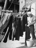Sailor Aboard a Us Navy Cruiser at Sea Hanging Up Laundered Dungarees During WWII Premium Photographic Print by Ralph Morse