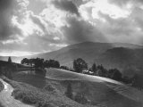 Big, Fluffy White Clouds, and Dark Low-Hanging Rain Clouds Hovering Close to the Mountain Tops Premium Photographic Print by George Rodger