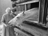 Mrs. Mary Breckenridge Runs the Frontier Nursing Service, Petting Her Horse Premium Photographic Print by Eliot Elisofon