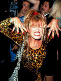 Designer Betsey Johnson Baring Teeth in Cat Pose at Party for Helmut Newton, Barneys Clothing Store Premium Photographic Print by Dave Allocca