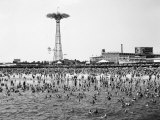 Bathers Enjoying Coney Island Beaches. Parachute Ride and Steeplechase Park Visible in the Rear Photographie par Margaret Bourke-White