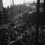 Ferry Boat Commuters from Staten Island Disembarking at Ferry Slip in Manhattan Photographic Print by Andreas Feininger