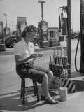 Girl Change Maker Knitting During Slow Moments at the Gilmore Self-Service Gas Station Premium Photographic Print by Allan Grant