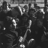 Folk Singer Woody Guthrie Playing Guitar for Group of Children Premium Photographic Print by Eric Schaal