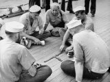 Sailors Aboard a Us Navy Cruiser at Sea Playing a Game of Dominoes on Deck During WWII Reproduction photographique sur papier de qualité par Ralph Morse