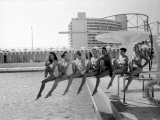 Fashion Models Wearing Swimsuits at the Eden Roc Swimming Pool Premium Photographic Print by Lisa Larsen