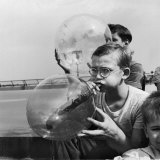 Two Young Boys Blowing Large Transparent Bubbles with a Blow-Straw Dipped in a Soft Plastic Photographic Print by Alfred Eisenstaedt