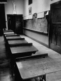 Looking Down Row of Empty Scarred Old Fashioned Desks in Schoolroom Premium Photographic Print by Walter Sanders