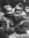 Lapp Woman Holding Her Child Premium Photographic Print by Mark Kauffman