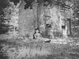 Miss Colwell Sitting Against Two Trees by a Small House Premium Photographic Print by Wallace G. Levison