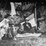 Kazak Family Sitting on Floor and Eating Photographic Print by William Vandivert