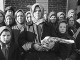 Russian Woman Grimly Holding a Slab of Meat as Other Peasant Women Staunchly Stand by in Siberia Premium Photographic Print by Margaret Bourke-White
