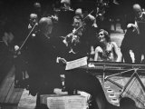 Sir Thomas Beecham Conducting Orchestra as Lady Beecham Plays Piano Premium-Fotodruck von Michael Rougier