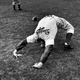 Brooklyn Dodgers Pitcher Ed Albosta Doing Stretching Exercise During Spring Training Premium Photographic Print by William Vandivert