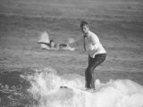 Surfer Riding a Wave While Wearing a Tuxedo Premium Photographic Print by Allan Grant