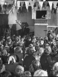 """Group of Young School Children Watching a """"Punch and Judy Show"""" Premium Photographic Print by George Rodger"""