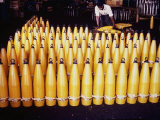 Worker Inspecting 115 Mm Shells on Production Line at Birmingham Steel Production Center Premium Photographic Print by Dmitri Kessel