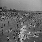 Huge Crowd Gathered in the Surf and at the Beach in Front of Coney Island Amusement Park Photographic Print by Marie Hansen