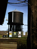Photo Taken from Window of a Train Showing Water Storage Tower Beside Tracks Premium Photographic Print by Walker Evans