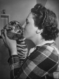 Mrs. Martini, Wife of the Bronx Zoo Lion Keeper, Kissing a Tiger Cub Premium Photographic Print by Alfred Eisenstaedt