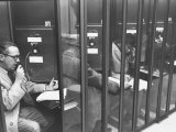 Unemployed Executive Making Appointments for Interviews from Telephone Booth Premium Photographic Print by Leonard Mccombe