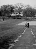 Distant of Mathematicians Albert Einstein and Kurt Godel Taking a Walk Premium Photographic Print by Leonard Mccombe