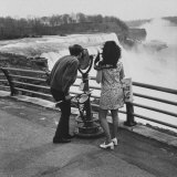 Honeymoon Couple, Colman Laposa Jr. and Wife, Gazing at the Niagara Falls Photographic Print by Yale Joel