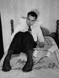 Vice Presidential Candidate Richard M. Nixon Sitting on His Hotel Bed Reviewing Paperwork Premium Photographic Print by Cornell Capa