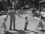 Father Playing in Yard with His Children Premium Photographic Print by Wallace Kirkland