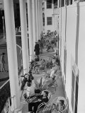 Porch-Sitting, One of Miamians Major Outdoor Sports, White House Hotel Premium Photographic Print by Alfred Eisenstaedt