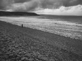 Along British Coastline, Woman Walking on Pebbled Shore Premium Photographic Print by Nat Farbman