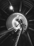 Workers Connecting Sections of Water Pipe in Tunnel Premium-Fotodruck von Ralph Crane