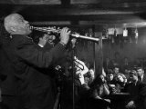 "Sidney Bechet Performing in Small Basement Club ""Vieux Colombier"" Premium Photographic Print by Nat Farbman"