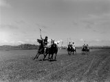 Polo Game in Progress at the Canlubang Sugarcane Plantation Photographic Print by Carl Mydans