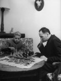 Prince Jaun Carlos and His Chaplain Father Zukueta, Playing Chess Premium Photographic Print by Dmitri Kessel