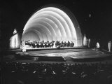 Singer Margaret Truman Standing on Stage at the Hollywood Bowl with a Large Band Behind Her Premium Photographic Print by Allan Grant