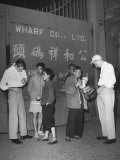 Peddlers at Gate to Shanghai Selling Curios to Two American Sailors Premium Photographic Print