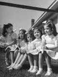The Dionne Quintuplets Posing for a Picture Premium Photographic Print by Hansel Mieth