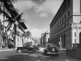 Cars Crossing an Intersection on a Downtown Honolulu Street with Mountains in the Background Premium Photographic Print