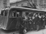 People Loading into the Electric Trolley Bus Premium Photographic Print