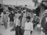 Arabs Shopping in the Village Premium Photographic Print by Ralph Crane