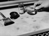 Fingerprint Powder, Brush and Magnifying Glass Used in the Detection of the Prints Photographic Print by Carl Mydans