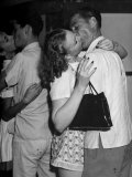 Members of the Tip Toppers Club for Tall People Kissing at a Party Premium Photographic Print by Peter Stackpole