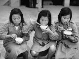 "Young Members of ""Young Girl's Training Corps"" Eating a Meal Premium Photographic Print by Carl Mydans"