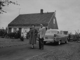 An Levittown Couple, Standing in Front of their New Home Premium Photographic Print