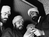 Sikhs Doing Community Singing with the Hymn Book in their Hands Premium Photographic Print