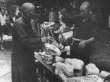 Man Buying Brick of Salt at Market Premium Photographic Print by Carl Mydans